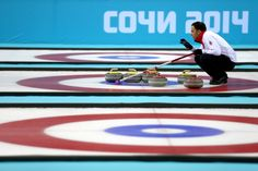 David Murdoch of Great Britain lines up a move with his team-mates during the men's semifinal match between Sweden and Great Britain (c) Getty Images