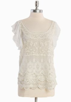 """Whimsical Tale Crochet Top 39.99 at shopruche.com. Impeccably crafted, this delicate white chiffon top features a crocheted overlay in cream, a scalloped hem, and a whimsical flutter sleeves. Semi sheer.100% Polyester, Imported, 26"""" length from top of shoulders"""