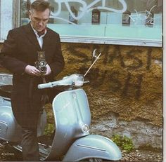 Morrissey with a Rolleiflex on a Vespa. It's hipster heaven.