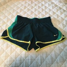 Teal and yellow Nike shorts Size small. great condition. Nike Shorts