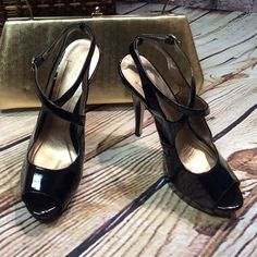 """BCBGIRLS PLATFORM HEEL Black patent leather strappy heels.. See 2nd pic of minor scuffs not noticed unless looking for them. Crisscross to a side buckle 5.5"""" heel BCBGirls Shoes Heels"""