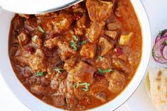 This is a traditional Indian dish for a classic lamb curry in creamy yoghurt, onion, tomatoes and  fragrance spices.Yoghurt in many Indian dishes, adds a pleasant tang and also thickens the sauce giving it a rich texture.This dish is best enjoyed with  Naan, chappatis or rice. Yogurt, Curry Recipes, Spicy Recipes, Meat Recipes, Best Curry Recipe, Cooking Recipes, Fiery Red, Garam Masala, Lamb Tikka Masala