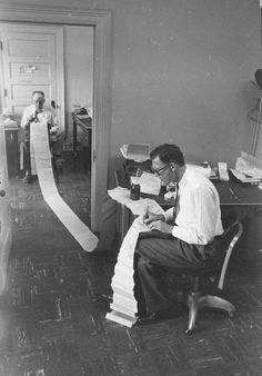 Denver Post columnist Red Fenwick (in background) and an unnamed editor work through a wire transmission in the 1960s.