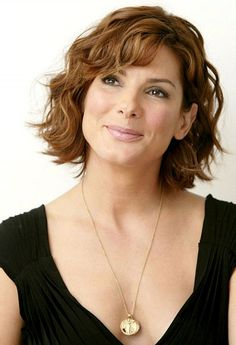 Short layered bob hairstyles for wavy hair with brown hair color and side bangs for mature women with square face