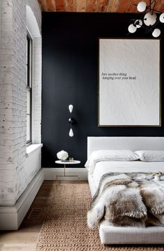I love the contrast of the charcoal, white and wood in this bedroom.