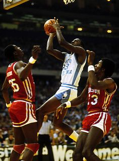 The GOAT in college scoring on a layup between fellow NBA HOFers Hakeem Olajuwon and Clyde Drexler during the 82 NCAA Final Four in New Orleans. Michael Jordan North Carolina, Michael Jordan Unc, Mike Jordan, Michael Jordan Pictures, Jeffrey Jordan, Nike Basketball Socks, I Love Basketball, Basketball Legends, Football And Basketball