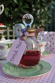 Drink Me Potion Bottle. Cute for an Alice in wonderland birthday theme. Have guests drink out of these bottles.