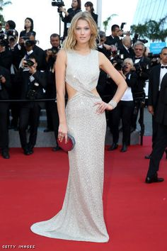 Toni Garrn in a Kaufmanfranco gown and a Rauwolf clutch