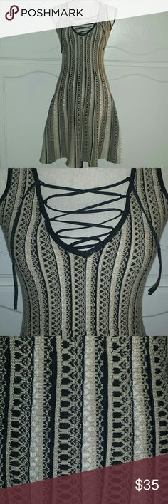 Dress Beautiful knitted fit and Flare Dress with lace up detail.  Size small.  Brand New.  Super stretchy material. Dresses