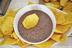 Delicious black bean hummus! So addicting & healthy. This would be great to serve at superbowl party for a healthy option that EVERYONE will love. & it's gluten free!