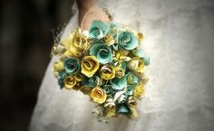 Low-key handmade crafty wedding - love these paper flower bouquets, they are so budget friendly.