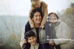 Stock Photo : Family together outdoors, father carrying daughter on his shoulders