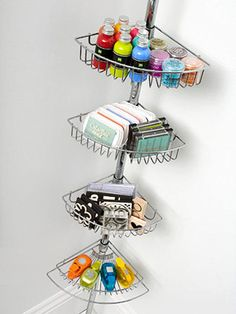 Tuck a tiered shower caddy originally designed to hold bath supplies in a corner of your scrapbook room to make the most of a small space. The baskets can hold any number of scrapbook supplies, including paints, ink pads, stamps, and punches. Corner Storage, Craft Room Storage, Craft Organization, Storage Ideas, Craft Rooms, Corner Shelf, Storage Solutions, Corner Unit, Office Storage