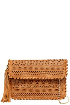 "It's easy to take your style on the road in the Chalk Mountain Tan Laser Cut Clutch! Tan vegan leather is covered in geometric laser cutouts and whip-stitching for a style that's totally unique. Front flap with tassel and hidden magnet closure, opens to a tan fabric-lined compartment, with a small zipper pocket at back. Carry as a clutch, or clip on the 51"" long gold chain strap."