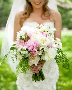 24 Best Spring Wedding Bouquets | Martha Stewart Weddings - Kendra worked with Beth Hohensee of Studio Flora Diva to create a larger-than-life clutch of mixed roses, ranunculus, and peonies accented with ferns and vines. As a sentimental touch, she wrapped a strand of her grandmother's pearls around the stems.