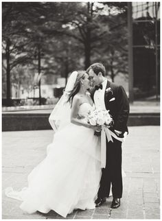 Bride and groom. Bride's dress by Hayley Paige from Hayden Olivia, bouquet by New Creations Flower Company. Black and white image by Lauren Rosenau Photography.
