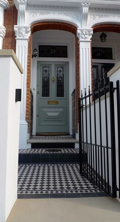 black and white victorian mosaic yorkstone render block wall wrought metal rail and gate notting hill  london