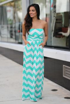 OMG!! This new Mint and White Chevron Maxi Dress with Pockets is too cute to be true! Our best seller ever chevron dress now in this lovely color combo! Amazing fit and super cute pockets! See other beautiful new arrivals on our online dress shop! 96% Polyester 4% Spandex Length: - small: 52.5 inches - medium: 53 inches - large: 53.5 inches Model is 5'6, 32 C bust, size 0/2 pants, size small top and is wearing a size small. Chevron pattern. Slinky/jersey material. Not lined. Elastic at back. Poc Bella Dresses, Combo Dress, Chevron Dress, Off White Color, Online Dress Shopping, Boutique Dresses, Color Combos, Strapless Dress, Model