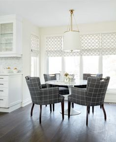 White and gray dining room features a Westport Pendant illuminating a round marble Saarinen Dining Table lined with gray tartan dining arm chairs placed in front of windows dressed in white and gray interlocking circles roman shades. Living Room Grey, Living Room Chairs, Dining Rooms, Dining Arm Chair, Dining Table, Arm Chairs, Round Marble Table, Condo Furniture, Most Comfortable Office Chair