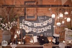 bride and groom put up photos of their family history- antique frames, hanging globes, ladder, doily runner from Southern Vintage rentals