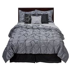 Target. wow.  The puckered quilting is so decadent, yet the bedding is understated with the soft color.  I would add tiffany blue pillows in spring and magenta ones in winter.