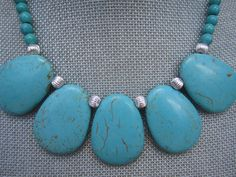 Turquoise Stone Statement Necklace with Silver Accent Beads.