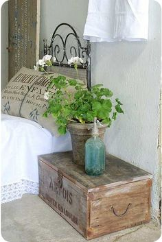 Old trunk as a night stand...plant and seltzer bottle...<3 them all!