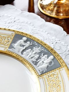 ♥♥♥ fabulous - raised, cloudy white pâte-sur-pâte decoration is created by brushing layers of 'slip' (liquid clay)which creates a sense of depth and a lovely transparency.  It is then carved to look like a cameo.  Here, a Minton dinner plate.