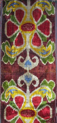 Uzbek silk velvet with a rich brown/burgundy ground, with blue, green, gold, red and natural color pattern, handwoven on narrow traditional looms.