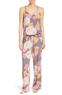 Slip into something dreamy with this flirty floral PJ set that pairs a swingy racerback tank with matching bottoms.