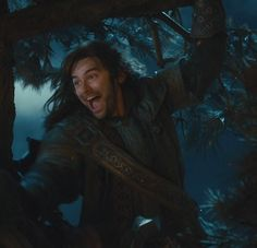 Kili enthusiastically throwing fiery pine-cones at the orcs. This face is priceless! <<< His face is literally always like this in terrifying situations...thank you Aiden Turner<< so true!! Lol X)