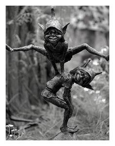 leap-frogging elves - garden ornaments