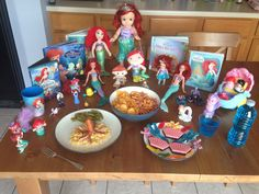 The Little Mermaid Dinner - Ursula Dogs (hot dogs cut to look like an octopus), Ariel's Shells and Cheese, King Triton's Seaweed (green beans), Scuttle's Ocean Water, Prince Eric's Ocean Jello, Flounder's Fish and Chips (potato chips and goldfish crackers) and Sebastian's Seashell Brownies (with sea life gummy candy) - The Little Mermaid Movie Night - Disney Movie Night - Family Movie Night