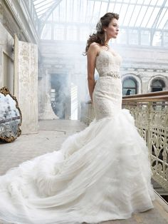 dramatic lace organza wave wedding gown with bolero jacket and asymmetrical skirt