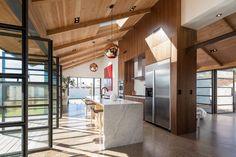 Kitchen w/ walnut cabinets in Phoenix Industrial Bungalow