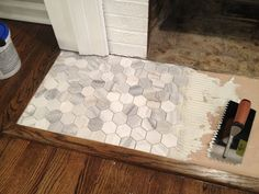 Love this hex tile hearth, though not sure if it would work with exposed brick.