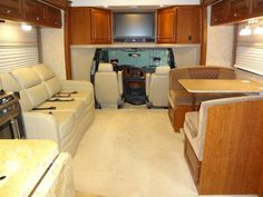 Triple Slide Chateau Citation Class C Coach w/ Rear Queen Bed Slide w/ Nightstand, Wardrobe/Dresser w/ LCD TV & Storage Overhead, Shower, Private. Four Winds Rv, Motor Homes For Sale, Wardrobe Dresser, Bed With Slide, Tv Storage, Queen Beds, Motorhome, Kitchen Cabinets, Baking