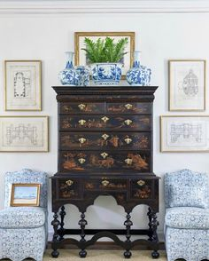 Dining room - Sweater chest, large gold mirror on top, Tommy Bahama dining chairs on each side, bamboo and/or mahogany framed art
