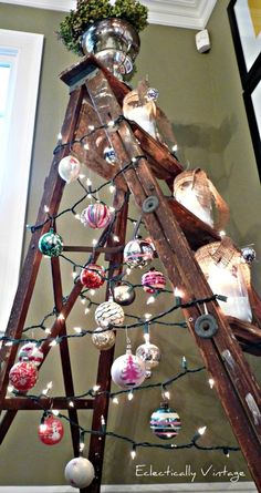 Ladder Christmas Tree - I love this - but my Mom would scream for an hour about hanging metal hooks from electrical wiring LOL. This wold be a fun tree in a super modern home - especially if it were silver metal or painted white wood.
