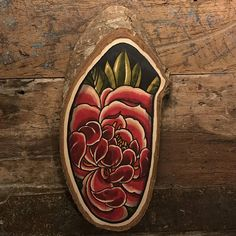 Wood slice with an original drawing of a peony