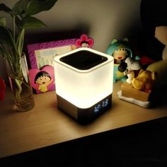 Ratings 4.3 Out Of 5* Brand: Aisuo  Product Review  It's definitely a great lamp which has multiple functions. I was surprised by the speaker that the quality of sound is really good and no broken sounds. I like the light which is beautiful and you can choose what colors you like. The design of the lamp is simple but very modern. The lamp has many functions, such as alarm, light, speaker and calendar. But it is not difficult to use.  More To Know Link Is In Description Below Sleep Headphones, Vinyl Record Player, Mp3 Player, Best Kindle, Sensor Night Lights, Literary Gifts, Light Music, Day Book, Used Vinyl