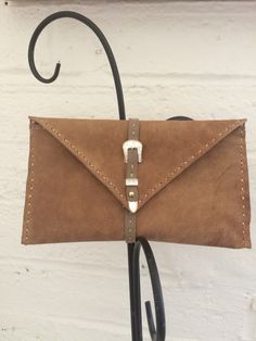 Distressed brown Italian leather clutch with buckle closure - SOLD.
