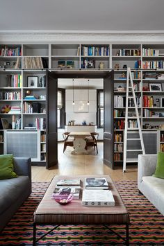 Library/Den, book shelves | modern living room by Sigmar | Get the Organizing Help You Need (Finally!)