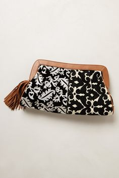 """- By Jasper & Jeera - Inner pocket - Zip closure - Cotton, leather; cotton lining - 7""""H, 15""""W, 3.5""""D - Imported"""