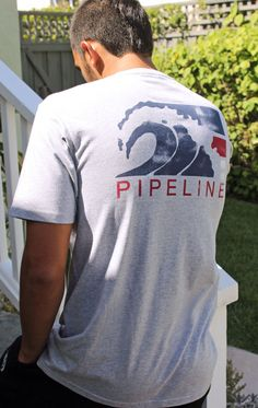 """The original PIPELINE® logo was first printed on a tee shirt in 1979, marking the beginning of this iconic lifestyle brand. We felt the time has come to finally bring it back… to remind all you """"vintage"""" surfers of simpler, more carefree times and to give some of the younger guys a chance to enjoy a bit of the surfin' 70's vibe themselves. Description: A classic tee shirt cut, made of soft 5.5 oz. Combed Cotton for ultimate comfort. Available Colors: WHITE and GREY HEATHER, Price: $17.95."""