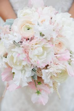 Blush bouquet with peonies, astilbe, ranunculus, sweet peas, garden roses and dusty miller. #chs #weddings #blush @pureluxebride. Photo by Dana Cubbage Weddings