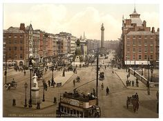 This is a beautiful old photo of Dublin, Ireland taken in the late 1890s. You're looking down O'Connell Street, formerly known as Sackville Street, across O'Connell Bridge.