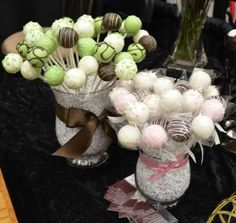 If you are looking for ways to save money on a wedding, think about how what you buy can serve more than one purpose. These cake pop centerpieces, for example, can be up to three functions 1) centerpiece, 2) dessert, and 3) favors.
