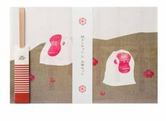 Printed in red and white — lucky colors in Japan — and offset with raffia lattice backgrounds, the New Year's Paper Luncheon and Chopstick set comes with five mats printed with auspicious motifs, including this year's Chinese Zodiac monkey, pine trees and Mount Fuji.