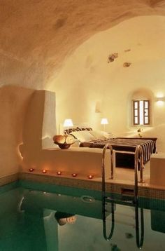 This is my dream bedroom. If you can't sleep dive in the pool and swim until your tired.
